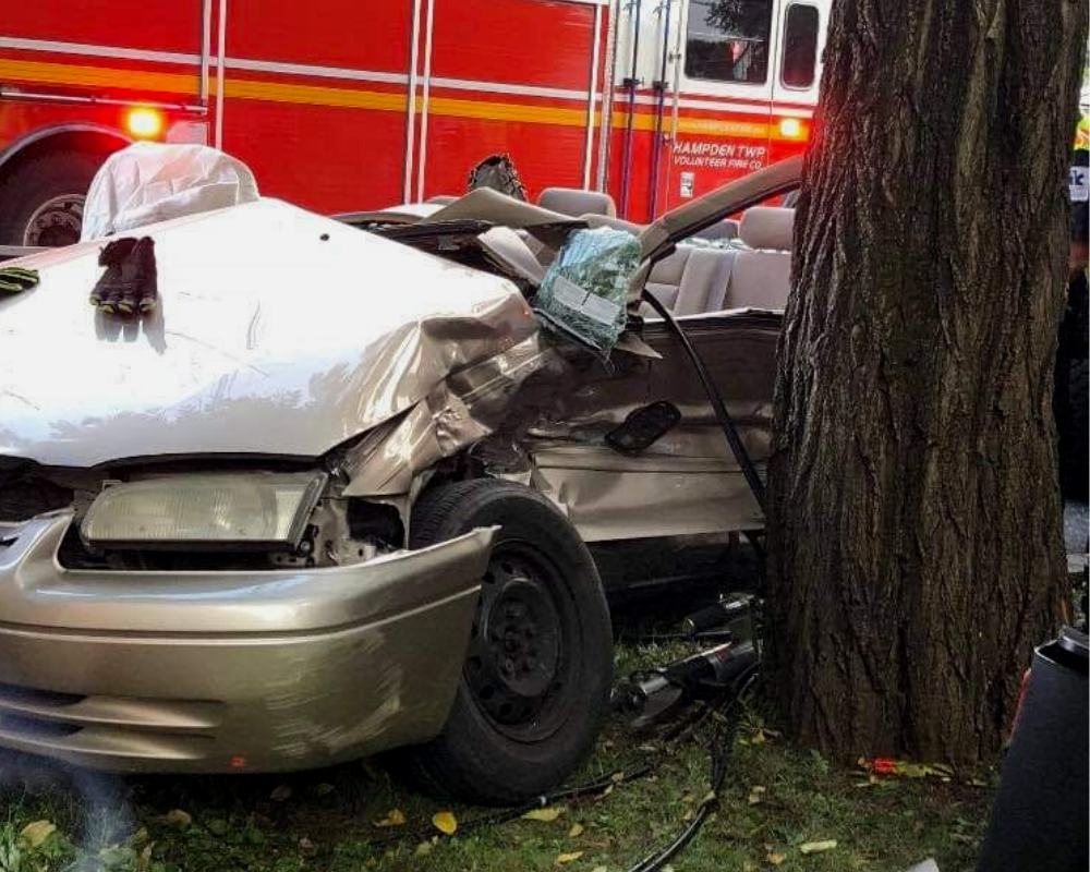 personal Injury car crash on a tree